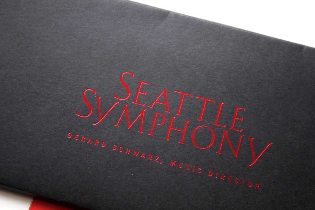 Red shiny foil on black paper | Season Tickets Packaging|  beautiful season ticket packets for Seattle Symphony  |   www.iwonak.com